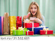 Купить «Cheerful girl opening box with gift», фото № 31532601, снято 6 апреля 2020 г. (c) Яков Филимонов / Фотобанк Лори