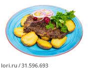 Купить «Prepared beef steak with fried potatoes and greens served», фото № 31596693, снято 22 июля 2019 г. (c) Яков Филимонов / Фотобанк Лори