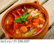 Купить «Bean's soup of broth cooked with boiled carrots, pepper and greens», фото № 31596697, снято 21 июля 2019 г. (c) Яков Филимонов / Фотобанк Лори