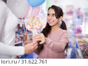 Купить «Portrait of girl daughter with balloons receives lollipop», фото № 31622761, снято 22 января 2018 г. (c) Яков Филимонов / Фотобанк Лори