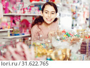 Купить «Emotional small girl choosing sweet candies in the candy shop», фото № 31622765, снято 22 января 2018 г. (c) Яков Филимонов / Фотобанк Лори