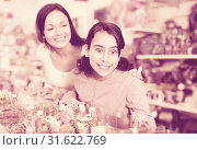 Купить «Woman with emotional daughter choosing candies in the candy shop», фото № 31622769, снято 22 января 2018 г. (c) Яков Филимонов / Фотобанк Лори