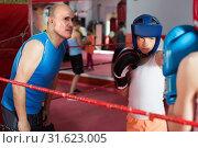 Купить «Boys training at boxing workout with coach on ring», фото № 31623005, снято 12 апреля 2017 г. (c) Яков Филимонов / Фотобанк Лори