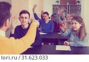Купить «Boys and girls 14-17 years old in class are ready to give answer», фото № 31623033, снято 28 февраля 2017 г. (c) Яков Филимонов / Фотобанк Лори