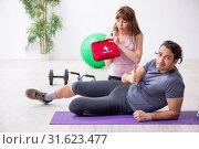 Купить «Young man feeling bad during training in first aid concept», фото № 31623477, снято 10 мая 2019 г. (c) Elnur / Фотобанк Лори
