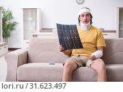 Купить «Young man after accident recovering at home», фото № 31623497, снято 3 мая 2019 г. (c) Elnur / Фотобанк Лори