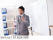 Купить «Young handsome businessman in front of whiteboard», фото № 31624589, снято 10 октября 2018 г. (c) Elnur / Фотобанк Лори
