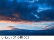 Купить «Небесный пейзаж. Sunset colorful sky background - pink, orange and blue dramatic colorful clouds lit by evening sunshine», фото № 31648005, снято 21 ноября 2018 г. (c) Зезелина Марина / Фотобанк Лори