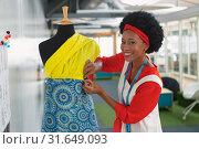 Купить «Female fashion designer dressing a mannequin in design studio», фото № 31649093, снято 16 марта 2019 г. (c) Wavebreak Media / Фотобанк Лори