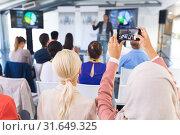 Купить «Close-up of female executive clicking photo of business seminar with mobile phone», фото № 31649325, снято 16 марта 2019 г. (c) Wavebreak Media / Фотобанк Лори