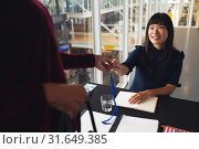 Купить «Female executive giving employee id to Businesswoman at conference registration table», фото № 31649385, снято 16 марта 2019 г. (c) Wavebreak Media / Фотобанк Лори