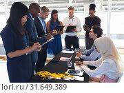 Купить «Business people checking in at conference registration table», фото № 31649389, снято 16 марта 2019 г. (c) Wavebreak Media / Фотобанк Лори