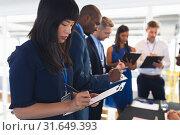 Купить «Business people checking in at conference registration table», фото № 31649393, снято 16 марта 2019 г. (c) Wavebreak Media / Фотобанк Лори