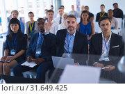 Купить «Businessman raising his hand while attending business seminar», фото № 31649425, снято 16 марта 2019 г. (c) Wavebreak Media / Фотобанк Лори
