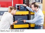 Купить «pair choosing home safe box», фото № 31650537, снято 17 апреля 2018 г. (c) Яков Филимонов / Фотобанк Лори