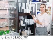 Купить «woman choosing bottle for liquid soap», фото № 31650701, снято 2 мая 2018 г. (c) Яков Филимонов / Фотобанк Лори