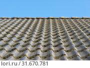 Купить «Roof hung with gray concrete roof tiles as background picture», фото № 31670781, снято 21 июля 2019 г. (c) easy Fotostock / Фотобанк Лори