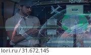 Купить «Warehouse Composition Delivery man standing next to a van combined with illustration», видеоролик № 31672145, снято 30 сентября 2018 г. (c) Wavebreak Media / Фотобанк Лори