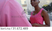 Купить «Women hugging each other in balcony at home 4k», видеоролик № 31672489, снято 29 августа 2018 г. (c) Wavebreak Media / Фотобанк Лори