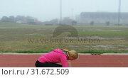 Купить «Female athlete running on a running track 4k», видеоролик № 31672509, снято 17 апреля 2018 г. (c) Wavebreak Media / Фотобанк Лори