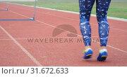 Купить «Female athlete exercising on a running track 4k», видеоролик № 31672633, снято 17 апреля 2018 г. (c) Wavebreak Media / Фотобанк Лори