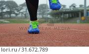 Купить «Low section of female athlete exercising on a running track 4k», видеоролик № 31672789, снято 17 апреля 2018 г. (c) Wavebreak Media / Фотобанк Лори