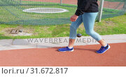 Купить «Side view of Caucasian female athlete walking on race track at sports venue 4k», видеоролик № 31672817, снято 17 апреля 2018 г. (c) Wavebreak Media / Фотобанк Лори