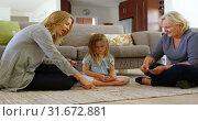 Купить «Multi-generation family playing cards in living room 4k», видеоролик № 31672881, снято 24 августа 2018 г. (c) Wavebreak Media / Фотобанк Лори