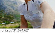 Купить «Senior cyclist getting ready for cycling at countryside 4k», видеоролик № 31674621, снято 21 августа 2018 г. (c) Wavebreak Media / Фотобанк Лори