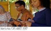 Купить «Commuters using mobile phone at bus stop 4k», видеоролик № 31687197, снято 10 июня 2018 г. (c) Wavebreak Media / Фотобанк Лори