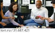 Купить «Executives discussing over architectural model and sticky note 4k», видеоролик № 31687421, снято 1 сентября 2018 г. (c) Wavebreak Media / Фотобанк Лори
