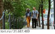 Купить «Couple walking together in the city 4k», видеоролик № 31687489, снято 2 августа 2018 г. (c) Wavebreak Media / Фотобанк Лори
