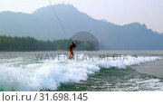 Купить «Man wakeboarding in the river 4k», видеоролик № 31698145, снято 22 августа 2018 г. (c) Wavebreak Media / Фотобанк Лори