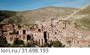 Купить «View from drone of Albarracin cityscape with ancient defensive walls and Cathedral tower, Aragon, Spain», видеоролик № 31698193, снято 26 декабря 2018 г. (c) Яков Филимонов / Фотобанк Лори