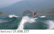 Купить «Man wakeboarding in the river 4k», видеоролик № 31698377, снято 22 августа 2018 г. (c) Wavebreak Media / Фотобанк Лори