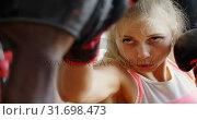 Купить «Trainer training female boxer in fitness studio 4k», видеоролик № 31698473, снято 6 сентября 2018 г. (c) Wavebreak Media / Фотобанк Лори