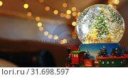 Купить «Crystal ball toy during Christmas at home 4k», видеоролик № 31698597, снято 28 сентября 2018 г. (c) Wavebreak Media / Фотобанк Лори