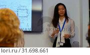 Купить «Businesswoman giving presentation in conference room at office 4k», видеоролик № 31698661, снято 23 августа 2018 г. (c) Wavebreak Media / Фотобанк Лори