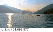Купить «Tourists fishing on a boat 4k», видеоролик № 31698877, снято 30 июля 2018 г. (c) Wavebreak Media / Фотобанк Лори