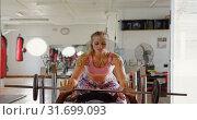 Купить «Trainer training male boxer in fitness studio 4k», видеоролик № 31699093, снято 6 сентября 2018 г. (c) Wavebreak Media / Фотобанк Лори