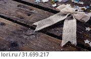 Купить «Falling snow with Christmas decoration ribbon», видеоролик № 31699217, снято 2 ноября 2018 г. (c) Wavebreak Media / Фотобанк Лори