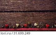 Купить «Falling snow with Christmas decorations on wood», видеоролик № 31699249, снято 2 ноября 2018 г. (c) Wavebreak Media / Фотобанк Лори