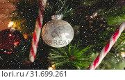 Купить «Falling snow with Christmas decorations», видеоролик № 31699261, снято 2 ноября 2018 г. (c) Wavebreak Media / Фотобанк Лори
