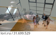 Купить «Digital animation of real estate agent showing house to couple 4k», видеоролик № 31699529, снято 26 октября 2018 г. (c) Wavebreak Media / Фотобанк Лори