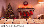 Купить «Blurred background of a living room decorated for christmas combined with falling snow», видеоролик № 31699553, снято 2 ноября 2018 г. (c) Wavebreak Media / Фотобанк Лори