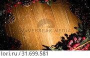 Купить «Falling snow with Christmas holly decoration», видеоролик № 31699581, снято 2 ноября 2018 г. (c) Wavebreak Media / Фотобанк Лори