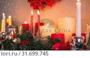 Купить «Falling snow with Christmas candles», видеоролик № 31699745, снято 2 ноября 2018 г. (c) Wavebreak Media / Фотобанк Лори