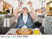 Купить «Fatty woman eating pizza, unhealthy food», фото № 31699949, снято 24 мая 2019 г. (c) Tryapitsyn Sergiy / Фотобанк Лори