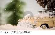 Купить «Model car with a fir cone on its roof on a carpet combined with falling snow», видеоролик № 31700069, снято 2 ноября 2018 г. (c) Wavebreak Media / Фотобанк Лори