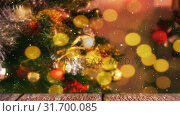 Купить «Blurred christmas tree combined with falling snow», видеоролик № 31700085, снято 2 ноября 2018 г. (c) Wavebreak Media / Фотобанк Лори